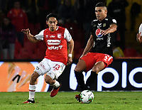 BOGOTA-COLOMBIA, 21-02-2020: Fabian Sambueza de Independiente Santa Fe y Carlos Sierra de America de Cali disputan el balon durante partido de la fecha 6 entre Independiente Santa Fe y America de Cali, por la Liga BetPLay DIMAYOR I 2020, en el estadio Nemesio Camacho El Campin de la ciudad de Bogota. / Fabian Sambueza of Independiente Santa Fe and Carlos Sierra of America de Cali vie for the ball during a match of the 6th date between Independiente Santa Fe and America de Cali, for the BetPlay DIMAYOR I Leguaje 2020 at the Nemesio Camacho El Campin Stadium in Bogota city. / Photo: VizzorImage / Luis Ramirez / Staff.