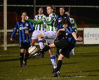 20131213 - VARSENARE , BELGIUM : Brugge's Ingrid De Rycke (right) pictured shooting towards goal with Zwolle's Jennieke Van Der Pol in front of her during the female soccer match between Club Brugge Vrouwen and PEC Zwolle Ladies , of  matchday 14  in the BENELEAGUE competition. Friday 13th December 2013. PHOTO DAVID CATRY