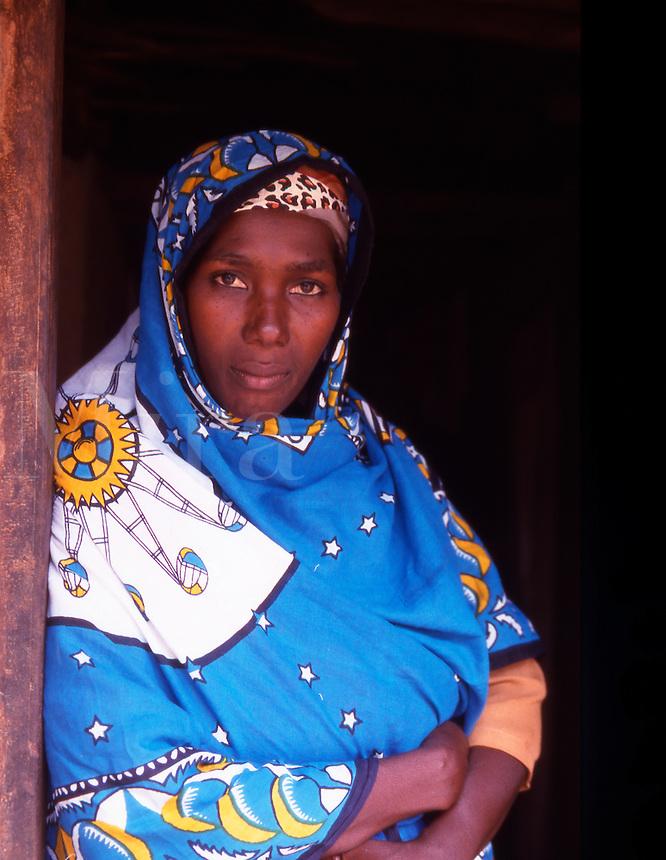 Zanzibar. A village lady wearing the traditional Khanga..