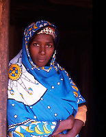 Zanzibar. A village lady wearing the traditional Khanga..