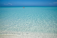 Swimmers walking  on shallow shoreline.  Turks and Caicos. Providenciales