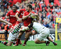 Schalk Brits of Saracens is tackled during the Aviva Premiership match between Saracens and Harlequins at Wembley Stadium on Saturday 31st March 2012 (Photo by Rob Munro)
