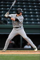 Second baseman Daniel Seeba (5) of the USC Upstate Spartans bats in a game against the Furman University Paladins on Tuesday, March 4, 2013, at Fluor Field at the West End in Greenville, South Carolina. Furman won, 13-1. (Tom Priddy/Four Seam Images)