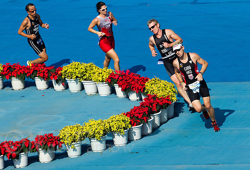 11 SEP 2011 - BEIJING, CHN - David Gibb (HKG) leads a group round a turn during the 2011 ITU World Age Group Olympic Distance Triathlon Championships (PHOTO (C) NIGEL FARROW)