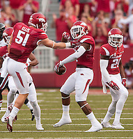 NWA Democrat-Gazette/BEN GOFF @NWABENGOFF<br /> Brooks Ellis (51), Arkansas linebacker, celebrates with DJ Dean (2), Arkansas cornerback, after Dean intercepted a pass intended for Texas Tech running back Justin Stockton in the first quarter on Saturday Sept. 19, 2015 during the game in Razorback Stadium in Fayetteville.