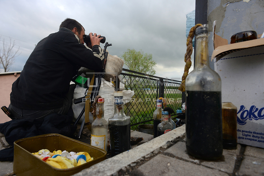 Pro-russian forces scouting for Ukrainian soldiers near the railroad. Molotov cocktails are part of their fight equipment. Slavyansk,  Donetsk region.