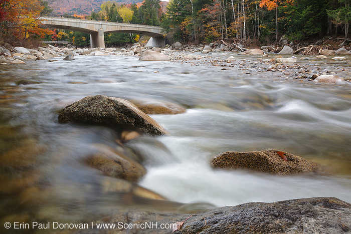 Street bridge, which crosses the East Branch of the Pemigewasset River along the Kancamagus Scenic Byway (Route 112) in Lincoln, New Hampshire during the autumn months. Built in 1938, this bridge crosses the river in the general area of where the East Branch & Lincoln Railroad's trestle No. 4 crossed.