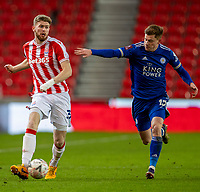 9th January 2021; Bet365 Stadium, Stoke, Staffordshire, England; English FA Cup Football, Carabao Cup, Stoke City versus Leicester City; Nathan Collins of Stoke City under pressure from Harvey Barnes of Leicester City
