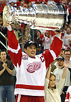 Detroit Red Wings captain Steve Yzerman hoists the Stanley Cup after Detroit defeated Carolina 3-1 in Game 5 of the Stanley Cup Finals, Thursday, June 13, 2002, at Joe Louis Arena in Detroit.  (The Oakland Press/Jose Juarez)