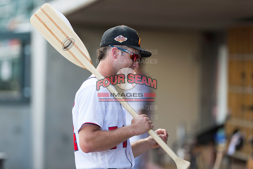 Salt River Rafters infielder Carter Kieboom (24), of the Washington Nationals organization, holds the rally oar in the dugout during an Arizona Fall League game against the Surprise Saguaros at Salt River Fields at Talking Stick on October 23, 2018 in Scottsdale, Arizona. Salt River defeated Surprise 7-5 . (Zachary Lucy/Four Seam Images)