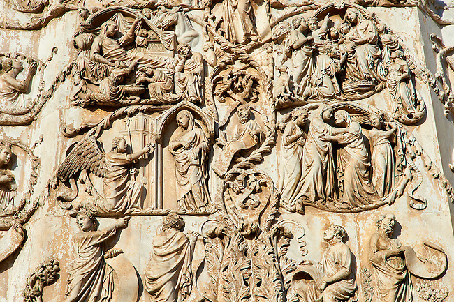 Bas-relief sculpture panel with scenes of the life of the Virgin Mary made by Maitani around 1310 on the14th century Tuscan Gothic style facade of the Cathedral of Orvieto, Umbria, Italy