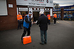 Chorley 2 Altrincham 0, 21/01/2017. Victory Park, National League North. A programme seller outside the entrance to Victory Park, before Chorley played Altrincham in a Vanarama National League North fixture. Chorley were founded in 1883 and moved into their present ground in 1920. The match was won by the home team by 2-0, watched by an above-average attendance of 1127. Photo by Colin McPherson.