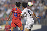 CHARLOTTE, NC - OCTOBER 03: Carli Loyd #10 of the United States and KIM Hyeyeong #5 of Korea Republic battle for a ball during during a game between USA and Korea Republic at Bank of American Stadium, on October 03, 2019 in Charlotte, NC.