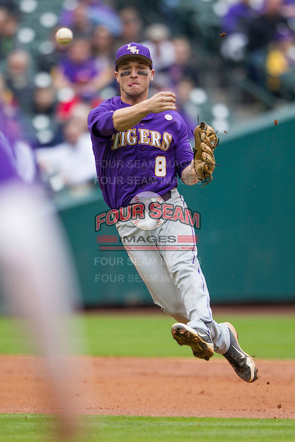 LSU Tigers shortstop Alex Bregman (8) makes a running throw to first base during the NCAA baseball game against the Baylor Bears on March 7, 2015 in the Houston College Classic at Minute Maid Park in Houston, Texas. LSU defeated Baylor 2-0. (Andrew Woolley/Four Seam Images)