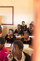 View of school children sitting at local village school and learning, in Lubombo Region, Eswatini
