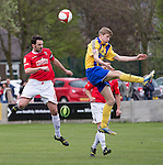 © Joel Goodman - 07973 332324 . 25/04/2015 . Salford , UK . Salford Captain Chris Lynch wins the ball in the air . Evostick League champions , Salford FC , play Osset Town , in Salford . Photo credit : Joel Goodman