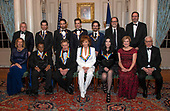 The recipients of the 41st Annual Kennedy Center Honors pose for a group photo following a dinner hosted by United States Deputy Secretary of State John J. Sullivan in their honor at the US Department of State in Washington, D.C. on Saturday, December 1, 2018.  From left to right back row: Deputy Secretary of State Sullivan, Thomas Kail, Lin-Manuel Miranda, Andy Blankenbuehler, Alex Lacamoire, Glenn Weiss, and Ricky Kirshner, Executive Producers with White Cherry. Front row, left to right: Grace Rodriguez, Wayne Shorter, Philip Glass, Reba McEntire, Cher, Deborah F. Rutter and David M. Rubenstein.  The 2018 honorees are: singer and actress Cher; composer and pianist Philip Glass; Country music entertainer Reba McEntire; and jazz saxophonist and composer Wayne Shorter. This year, the co-creators of Hamilton, writer and actor Lin-Manuel Miranda; director Thomas Kail; choreographer Andy Blankenbuehler; and music director Alex Lacamoire will receive a unique Kennedy Center Honors as trailblazing creators of a transformative work that defies category.<br /> Credit: Ron Sachs / Pool via CNP