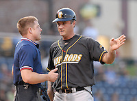 Sept. 3, 2009: Manager Matt Quatraro of the Bowling Green Hot Rods argues a call at first base with umpire Joseph Born during a game at Fluor Field at the West End in Greenville, S.C., Sept. 3, 2009. Photo by Tom Priddy/FourSeam Images