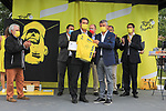 Bernard Thevenet ASO presents a Yellow Jersey to Erven Leon Mayor of Perros-Guirec, Vice-President de Lannion Tregor Communaute, Vice-President du departement des Cotes d'Armor in the Tour Village before Stage 2 of the 2021 Tour de France, running 183.5km from Perros-Guirec to Mur-de-Bretagne Guerledan, France. 27th June 2021.  <br /> Picture: A.S.O./Hervé Tarrieu   Cyclefile<br /> <br /> All photos usage must carry mandatory copyright credit (© Cyclefile   A.S.O./Hervé Tarrieu)