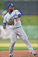 Chattanooga Lookouts third baseman Miguel Sano (24) between innings of a game against the Tennessee Smokies on April 25, 2015 in Kodak, Tennessee. The Smokies defeated the Lookouts 16-10. (Tony Farlow/Four Seam Images)