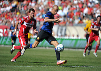 Manchester United midfielder Gabriel Obertan (26) takes a shot in front of Chicago Fire defender Gonzalo Segares (13).  Manchester United defeated the Chicago Fire 3-1 at Soldier Field in Chicago, IL on July 23, 2011.