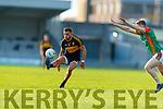 Micheál Burns, Dr. Crokes in action against Peter Crowley, Mid Kerry during the Kerry County Senior Football Championship Semi-Final match between Mid Kerry and Dr Crokes at Austin Stack Park in Tralee, Kerry.