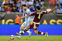 Foxborough, MA - Saturday June 18, 2016: Lionel Messi, Oswaldo Vizcarrondo during a Copa America Centenario quarterfinal match between Argentina (ARG) and Venezuela (VEN)  at Gillette Stadium.