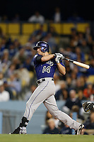 Josh Rutledge #14 of the Colorado Rockies bats against the Los Angeles Dodgers at Dodger Stadium on April 30, 2013 in Los Angeles, California. (Larry Goren/Four Seam Images)
