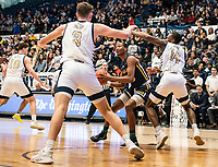 WASHINGTON, DC - FEBRUARY 22: Ed Croswell #11 of La Salle hemmed in by Maceo Jack #14 and Chase Paar #3 of George Washington during a game between La Salle and George Washington at Charles E Smith Center on February 22, 2020 in Washington, DC.