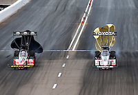 Feb 23, 2014; Chandler, AZ, USA; NHRA top fuel dragster driver Antron Brown (right) alongside Doug Kalitta during the Carquest Auto Parts Nationals at Wild Horse Motorsports Park. Mandatory Credit: Mark J. Rebilas-USA TODAY Sports