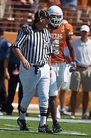 23 September 2006: Texas receiver Limas Sweed talks with a referee after making a long catch during the Longhorns 37-14 victory over the Iowa State Cyclones at Darrell K Royal Memorial Stadium in Austin, TX.