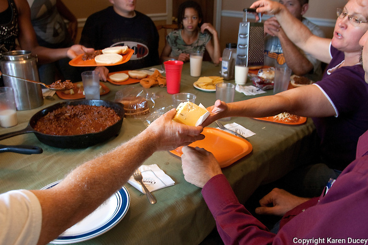 One of their specialty cheeses is passed around the table during lunchtime at the Estrella Family Creamery in Montesano,Wash. on November 4, 2010.  The Food and Drug Administration ordered the Estrella Family Creamery in Montesano,Wash.  to stop processing cheeses after it found listeria bacteria on some of the cheeses this year.  The family says they have made many renovations on the farm and the bacteria is only found on the soft cheese, not everything.  They believe they should be allowed to resume making cheese and sell the hard cheeses they have already made at the facility.  The creamery is one of Washington's most famous artisan cheesemakers.  (photo credit Karen Ducey). .