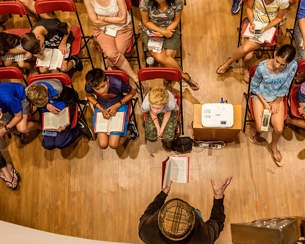 "July 26, 2017. Raleigh, North Carolina.<br /> <br /> The gathered crowd listens as Alan Gratz reads from his new book ""Refugee"".<br /> <br /> Author Alan Gratz spoke about and signed his new book ""Refugee"" at Quail Ridge Books. The young adult fiction novel contrasts the stories of three refugees from different time periods, a Jewish boy in 1930's Germany , a Cuban girl in 1994 and a Syrian boy in 2015."