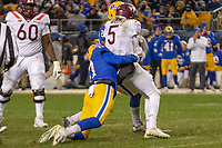 Pitt defensive lineman Rashad Weaver (17) tackles Virginia Tech quarterback Ryan Willis. The Pitt Panthers defeated the Virginia Tech Hokies 52-22 on November 10, 2018 at Heinz Field in Pittsburgh, Pennsylvania.