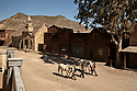 Spain - Andalusia - Three professional stuntmen walk around Fort Bravo with their horses. The three of them have appeared in several international movie productions.