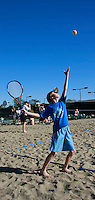 Eleven-year old Colton Kellog serves the ball to his father Jim during the Beach Tennis clinic at Barnes Tennis Center in Point Loma San Diego California USA, Saturday, February 9 2008.
