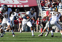 Shane Vereen (center) finds the pocket thanks to blocks by Michael Calvin (11) and Brian Schwenke (57). The University of California football defeated Washington State University 20-13 at Martin Stadium in Pullman, Washington on November 6th, 2010.
