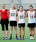 FRANKFURT AM MAIN, GERMANY - April 14: Astrid Hoffmann, Tessa Helf #22 of Germany, Magdalena Heiser #20 of Germany and Emily Patterson #19 of Germany during the national anthem before the Deutschland Lacrosse International Tournament match between Germany vs Great Britain during the on April 14, 2013 in Frankfurt am Main, Germany. Great Britain won, 10-9. (Photo by Dirk Markgraf)