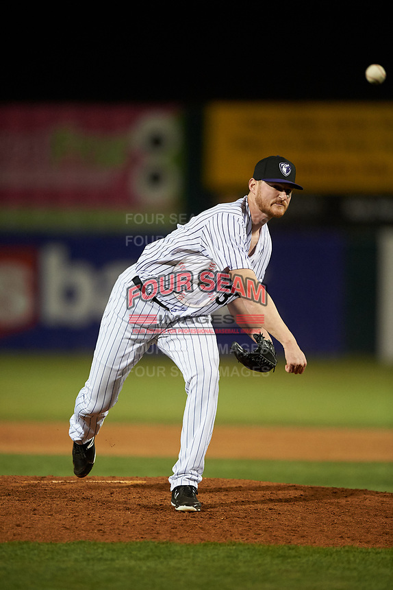 Lancaster JetHawks relief pitcher Bryan Baker (33) follows through on his delivery during a California League game against the Visalia Rawhide at The Hangar on May 17, 2018 in Lancaster, California. Lancaster defeated Visalia 11-9. (Zachary Lucy/Four Seam Images)