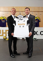 Pictured: Darren Vickers of Goldenway with club chairman Huw Jenkins. <br /> Re: Official launch of the 2013-2014 Swansea City Football Club kit launch, with sponsors Goldenway GWFX at the Liberty Stadium, Swansea, south Wales. Friday 28th of June 2013