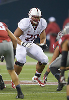 SEATTLE, WA - September 28, 2013: Stanford offensive tackle Andrus Peat blocks during play against Washington State at CenturyLink Field. Stanford won 55-17
