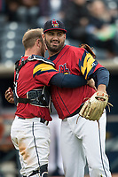 Toledo Mud Hens pitcher Arcenio Leon (34) is hugged by catcher Bryan Holaday (6) after defeating the Lehigh Valley IronPigs during the International League baseball game on April 30, 2017 at Fifth Third Field in Toledo, Ohio. Toledo defeated Lehigh Valley 6-4. (Andrew Woolley/Four Seam Images)