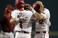 Arkansas infielder Robert Moore (1), catcher Charlie Welch (19) and catcher Casey Opitz (12) embrace following a home-run, Monday, June 7, 2021 in the eighth inning of the NCAA Fayetteville Regional at Baum-Walker Stadium in Fayetteville. Check out nwaonline.com/210608Daily/ for today's photo gallery. <br /> (NWA Democrat-Gazette/Charlie Kaijo)