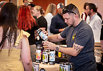 WATERBURY, CT 072231JS12 Larry Golia, Sales Manager for Counter Weight Brewing of Hamden, pours beers for guests during the third annual Summer Beer Fest held Friday at the Courtyard Marriott in Waterbury. <br /> Jim Shannon Republican American