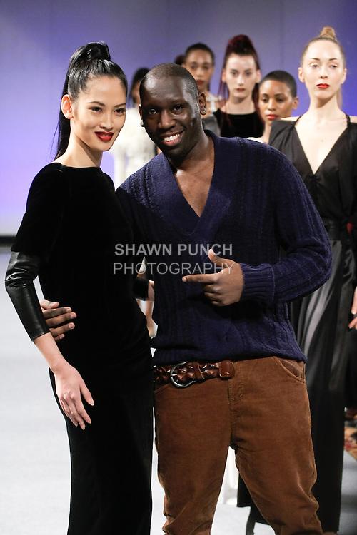 Elizabeth Thuytien walks runway with fashion designer Romero Bryan, at the close of the Romero Bryan Fall 2012 fashion show, during Couture Fashion Week New York Fall 2012.