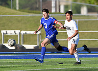 NWA Democrat-Gazette/CHARLIE KAIJO Rogers High School defender Dante Pardetti (3) and Bentonville High School Caleb Schipper (21) race to catch up to a loose ball during a soccer game, Friday, April 26, 2019 at  Whitey Smith Stadium at Rogers High School in Rogers.