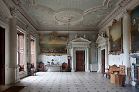 The elegant entrance hall of Badminton House, its ceiling and walls decorated with ornate stucco plasterwork