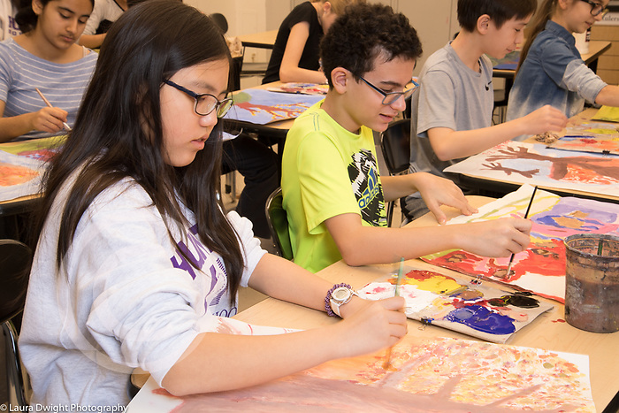 Education middle school grades 6 or 7 art class boy and girl working side by side