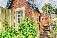 BNPS.co.uk (01202 558833)<br /> Pic: PropertyPublicity/BNPS<br /> <br /> Pictured: The home is called, The Keeper's Cottage<br /> <br /> Loco-cation, loco-cation, loco-cation..<br /> <br /> This quirky property that is up for sale is all about its loco-cation - as it sits on a railway crossing right next to the train tracks.<br /> <br /> The Grade II listed cottage was built in 1850 to house the gatekeeper whose job it was to close the gates at the road crossing whenever a train was due.<br /> <br /> The gates, in the village of Stone, Staffs, were automated many years ago.