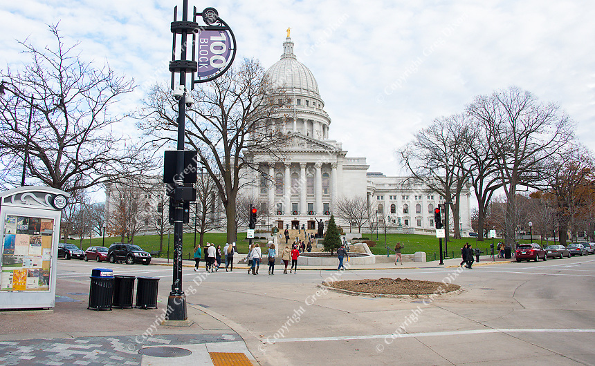 People walk by the State Capitol in downtown Madison, Wisconsin on Saturday, November 28, 2015